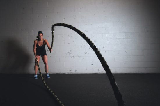 a woman training with ropes