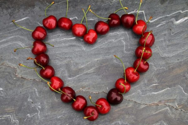Cherries in a shape of a heart
