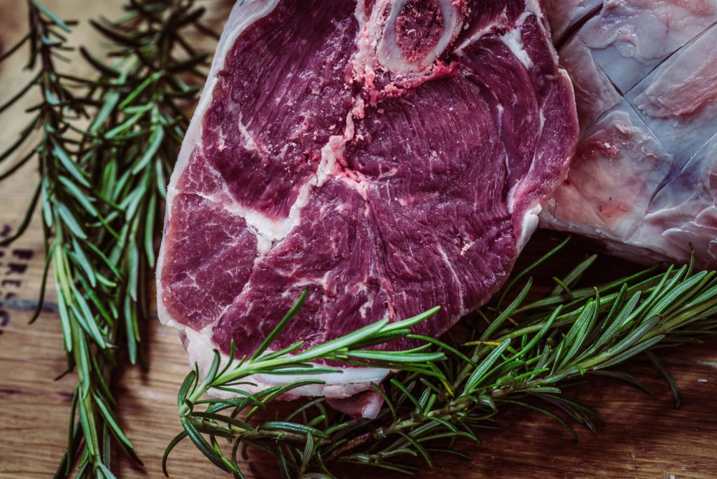 raw steak mixed with herbs