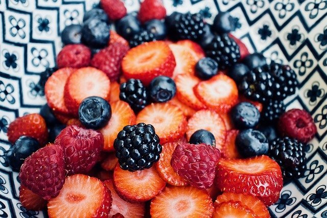 fruit and berries in a bowl
