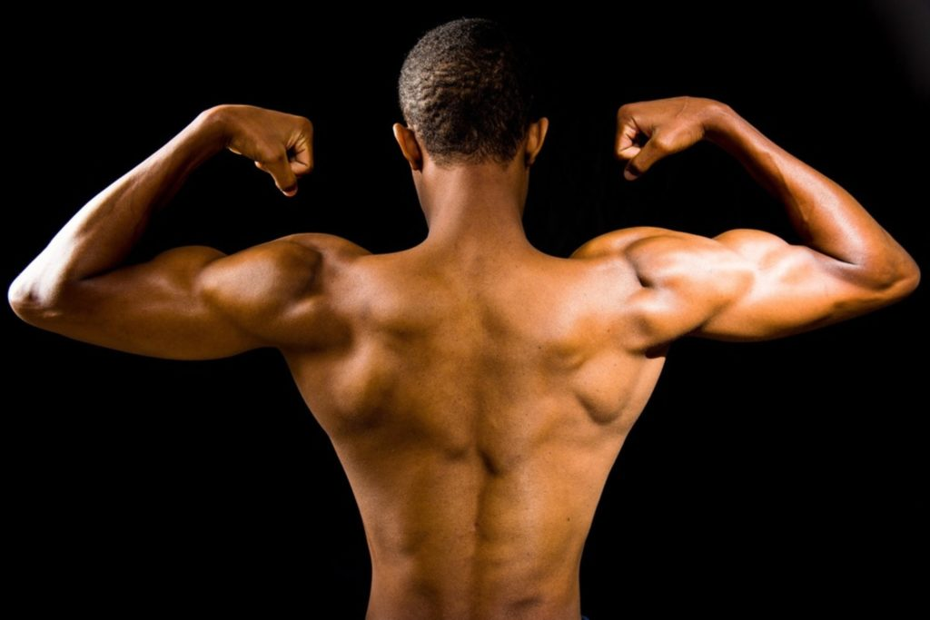 a man showing off his back muscles